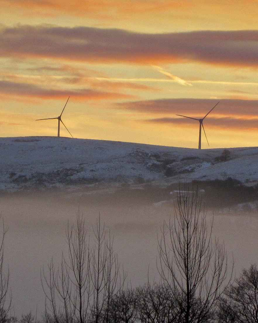 Wind energy park in snowy landscape